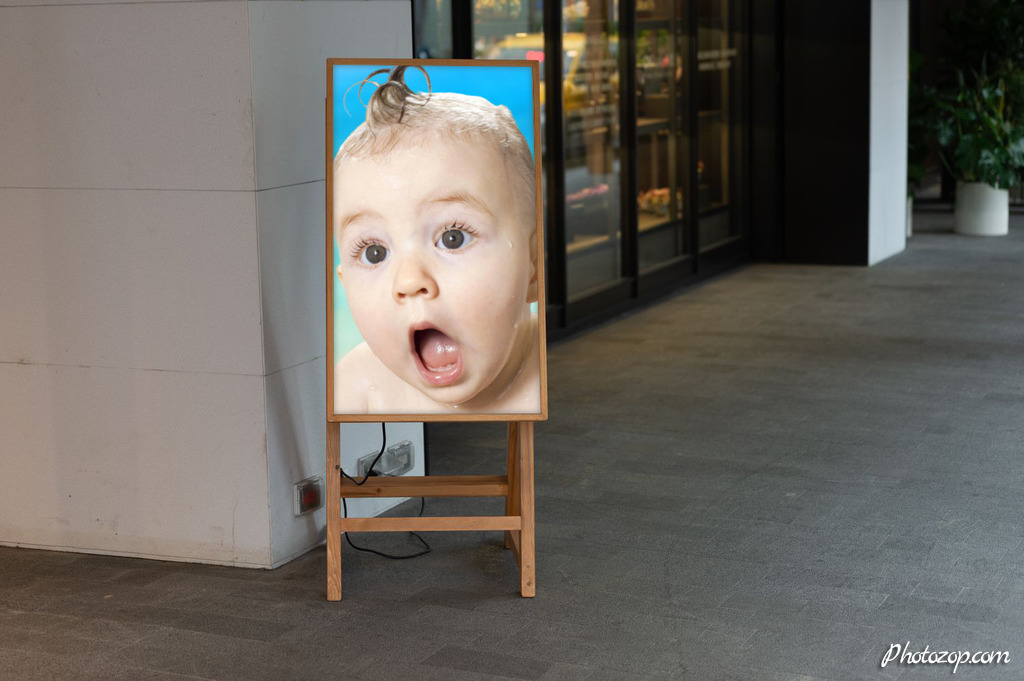 Create Funny Photo Montage billboard on a street wall